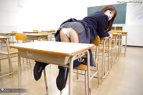 Bending over on seat in classroom uniform skirt raised over her ass wearing panties