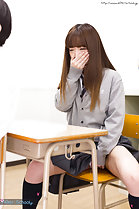 Hand clasped over her mouth legs spread masturbating in classroom