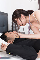 Leaning Over Student Lying On Bed