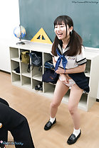 Standing in classroom skirt raised over her panties