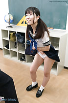 Standing in class hair in pigtails wearing uniform skirt raised white panties