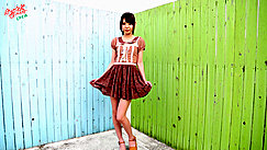 Ayana Standing In Back Yard Painted Fences Wearing Brown Dress In High Heels
