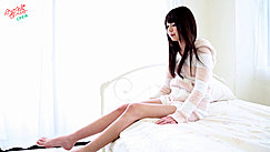 Ayana Seated On Bed Stretching Her Long Legs Long Hair Down To Her Breasts