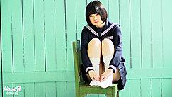 Sitting On Chair Knees Raised Short Hair Kogal Uniform Hands On Her Feet Wearing White Socks