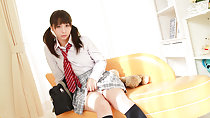Kogal sitting on couch hair in pigtails shirt and tie lifting hem of skirt up over her panties