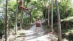 Walking Down Outdoor Trail Wearing Sun Hat In Short Dress