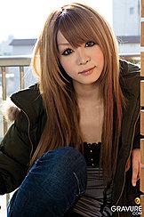 Sarina Tsubaki Seated On Balcony With Long Hair Coloured Auburn