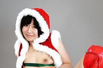 Santa Kuritorisu strips festive outfit and poses nude