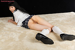 Lying On Her Front Plaid Uniform Skirt Over Her Bare Ass Wearing Shoes And Socks Long Hair Down Her Back
