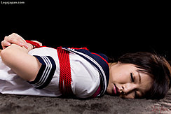 Kogal Lying Face Down Arms Tied Behind Her Back