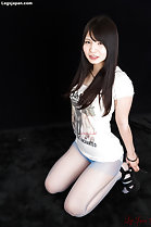 Iori Sana kneeling down long hair over her chest wearing tshirt in pantyhose hands on her high heels