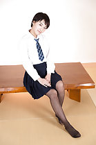 Seated on bench short hair in uniform wearing pantyhose